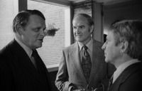 Senator George McGovern at a gathering at the home of Casper Weinberger (right), 